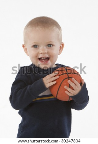 Little boy with basketball - stock photo