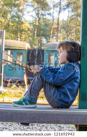 little boy with big headphone 2 - stock photo