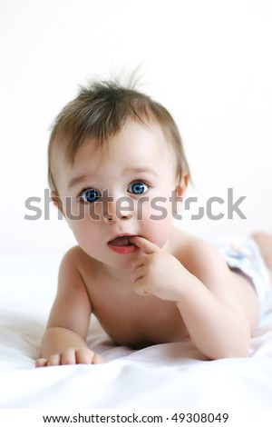 Little boy with blue eyes - stock photo