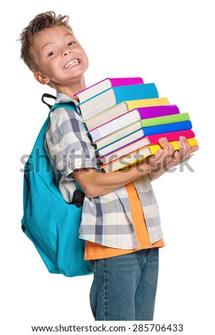 Little boy with books isolated on white background - stock photo