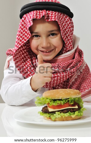 Little boy with burger - stock photo