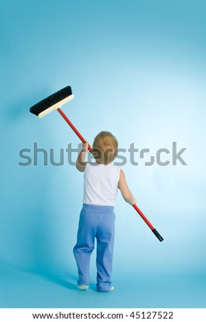 Little boy with cleaning swab over blue background - stock photo
