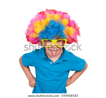 Little boy with clown wig mocking isolated on white background - stock photo