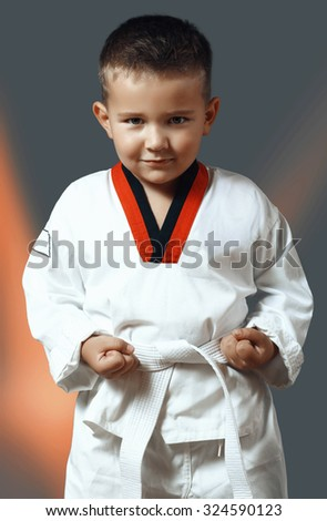 little boy with green eyes in white kimono - stock photo
