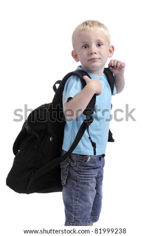 little boy with heavy backpack - stock photo