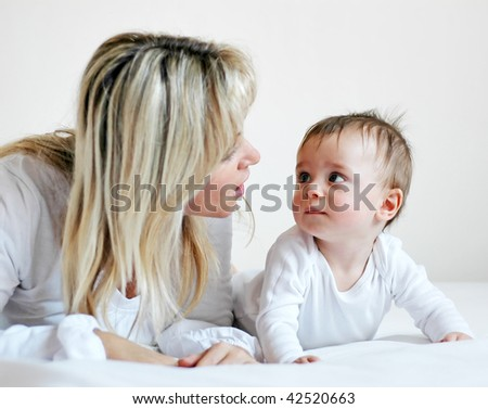 Little boy with his mother - stock photo