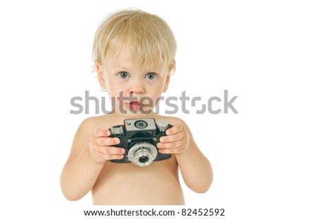 little boy with old photographic camera on white background - stock photo