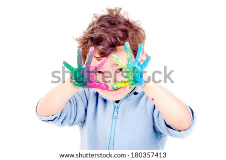 little boy with painted hands isolated in white - stock photo