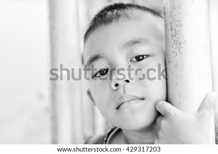Little boy with sadness face portrait in black and white. - stock photo