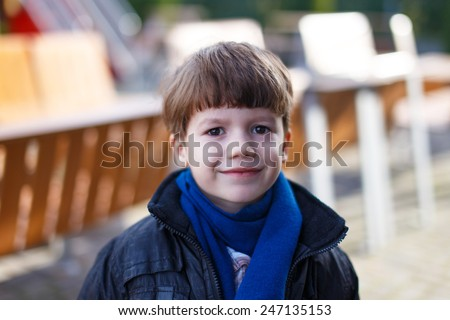 Little boy with scarf at winter, outdoor portrait - stock photo