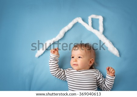little boy with shape of house - stock photo