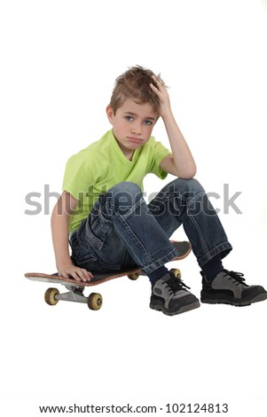 Little boy with skate board - stock photo