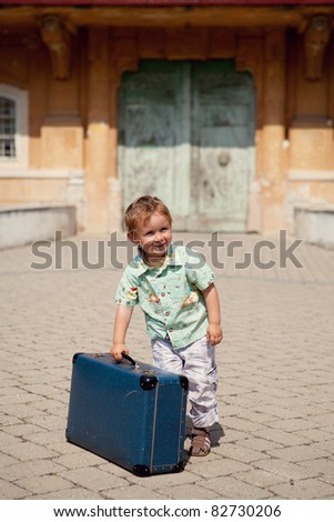 little boy with suitcase - stock photo