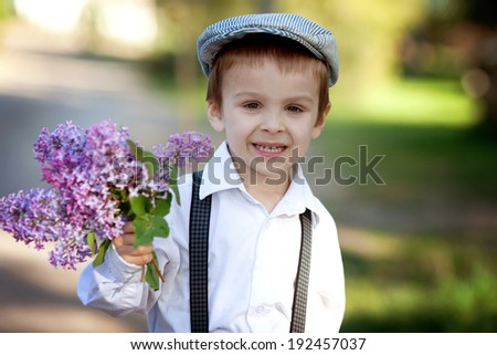 Little boy with suitcase and map, traveling - stock photo