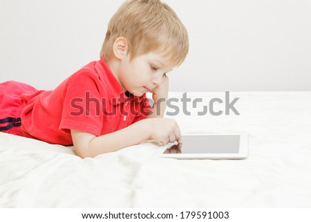 little boy with tablet, early learning - stock photo