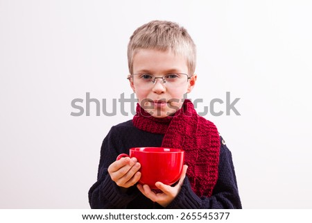 Little boy with tea cup - stock photo