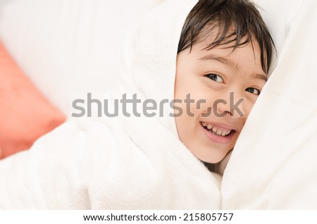 Little boy with towel cover - stock photo