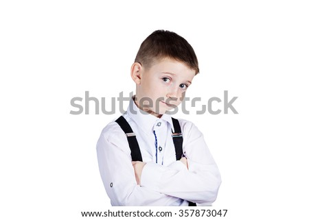 Little boy with wide open eyes looking to camera - stock photo