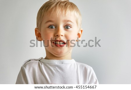 little boy wonder and fear, the child expresses emotions, face contorts, very soft focus - stock photo