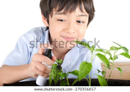 Little boy working with spaying for plant gardening - stock photo