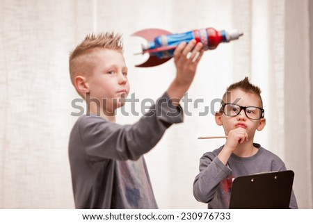 little boys playing as scientists or NASA engineers - stock photo
