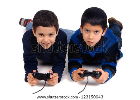 little boys playing video games - stock photo