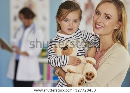 Little brave patient with her toy - stock photo