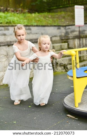 Little Bridesmaids playing in playground - stock photo