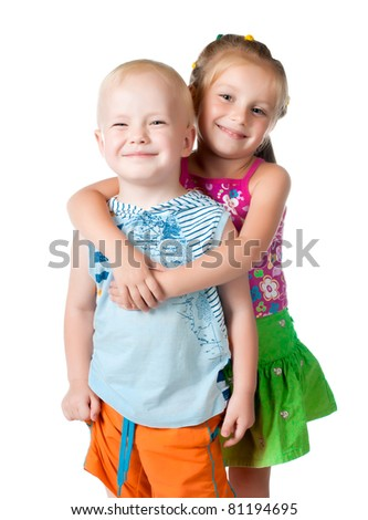 little brother and sister on a white background - stock photo
