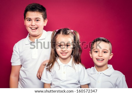 Little Brothers Smiling on a Red Background - stock photo