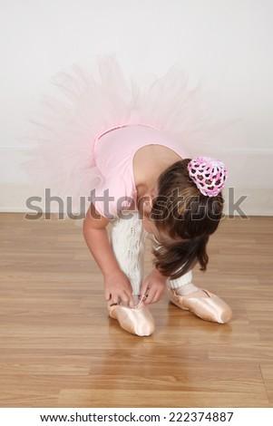 Little Brunette ballerina in the dance studio - stock photo