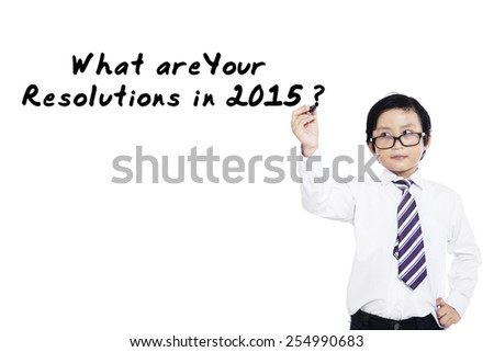 Little businessman writes a question about resolutions in 2015 - stock photo