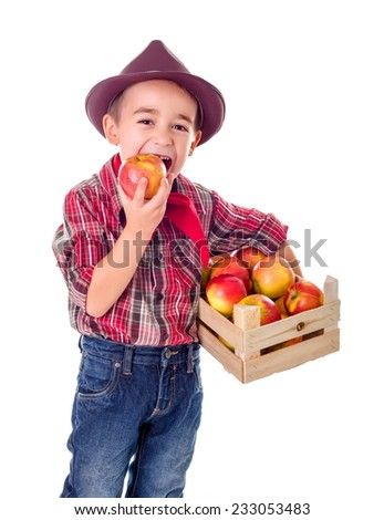 Little casual farmer boy tasting fresh harvested apple - stock photo