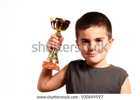 little champion with his trophy - stock photo