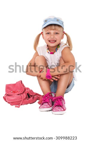 Little cheerful girl school girl in bright clothes on a white background isolated - stock photo