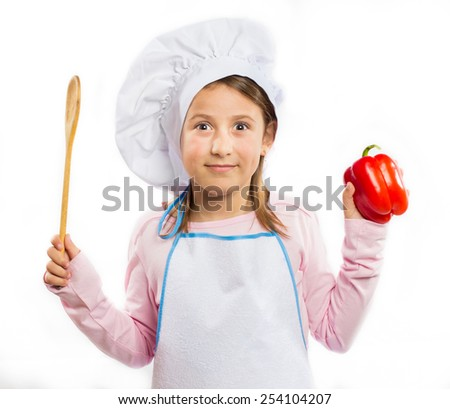 Little chef holding a  red pepper isolated on white background - stock photo
