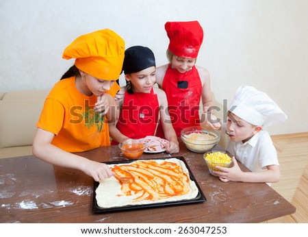 little chef in the kitchen preparing food - stock photo