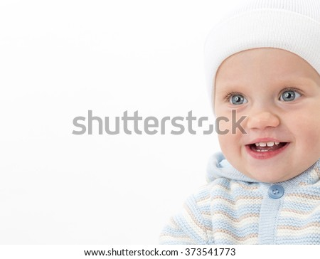 little child baby caucasian boy 1 year portrait face warm clothing hat smiling happy cheerful isolated on white studio shot teeth toothy smile - stock photo
