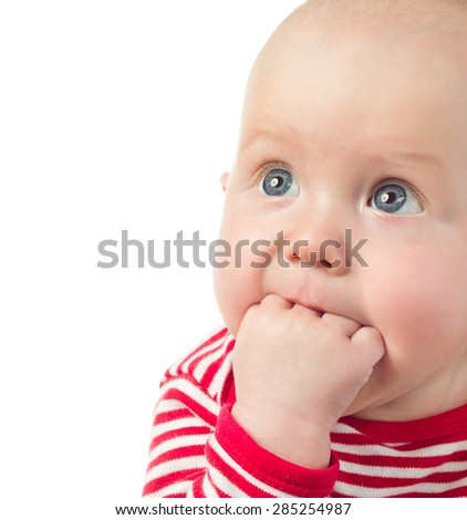 little child baby  closeup portrait isolated on white studio shot face looking up hand in mouth - stock photo
