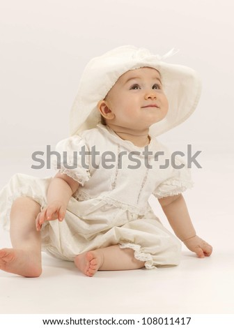 little child baby girl sitting on the chair indoors  smiling hat dress - stock photo