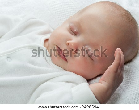 little child baby slipping on white - stock photo