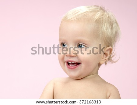 little child baby smiling happy cheerful on pink background emotions face teeth  caucasian 1 year portrait - stock photo