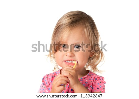 Little child brushes her teeth, isolated over white - stock photo