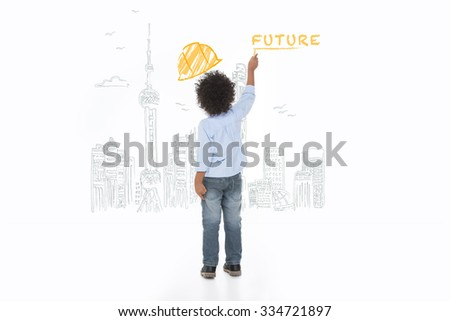 little child drawing a city sketch on a wall - stock photo