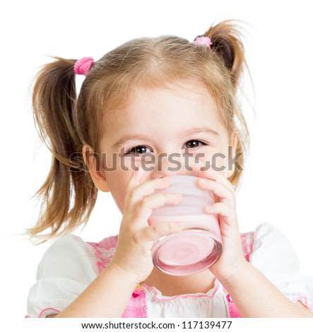 little child girl drinking yogurt or kefir over white - stock photo