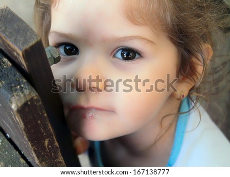 Little child girl looking seriously - stock photo