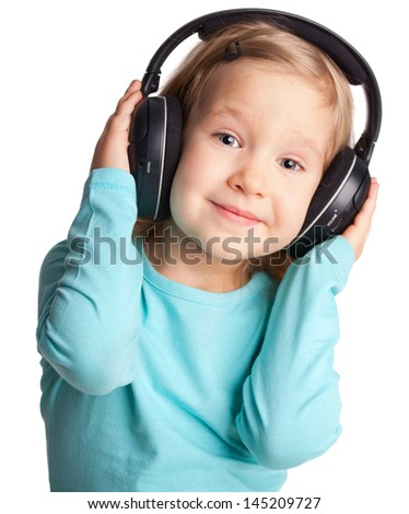 Little child in headphones isolated on white - stock photo