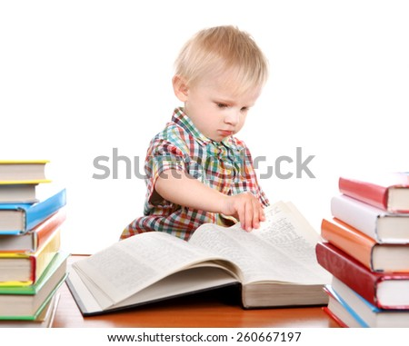 Little Child open the Book at the Desk Isolated on the White Background - stock photo