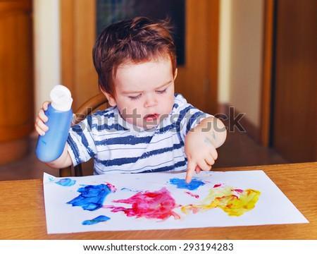 Little child painting - stock photo