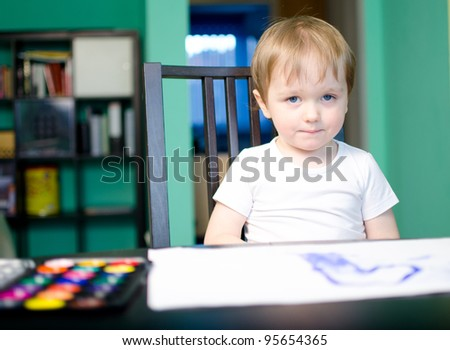 Little child painting with water colors paint - stock photo
